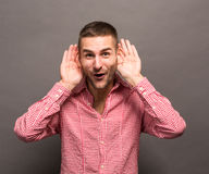 Man with his hands to ears Royalty Free Stock Photo