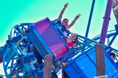 Man with his hands up and woman enjoying rollercoaster ride Tampa Bay aBush Gardens Tampa Bay. Tampa, Florida. October 25, 2018 Man with his hands up and woman royalty free stock images
