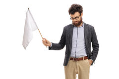 Man with his head down holding a white flag. Isolated on white background Royalty Free Stock Images