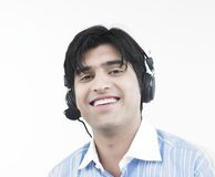 Man with his headphones on Royalty Free Stock Photography