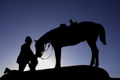 Man and his horse. Man looking after his horse Royalty Free Stock Image