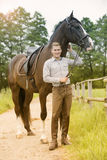 Man and his horse at a farm. Man and his brown horse at a farm Stock Photography