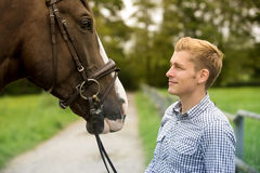 Man and his horse at a farm Royalty Free Stock Photography