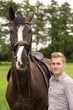 Man and his horse on farmland. Man and his brown horse on farmland Stock Photography