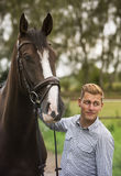 Man and his horse in nature. Man and his brown horse in nature Royalty Free Stock Photo