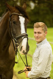 Man and his horse in nature. Man and his brown horse in nature Royalty Free Stock Photos
