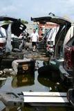 Man and His Junk Yard. A man looking at junk cars in a junk yard Royalty Free Stock Images