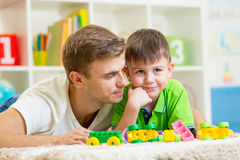 Man with his kid son play together at home Royalty Free Stock Photo
