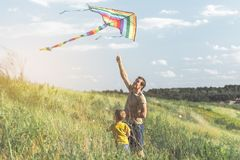 Father teaching his son to fly a kite Royalty Free Stock Photo