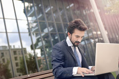 Man with his laptop. Business man with his laptop Stock Image