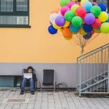 Man with his laptop at Fuorisalone during Milan Design Week 2015 Royalty Free Stock Photo