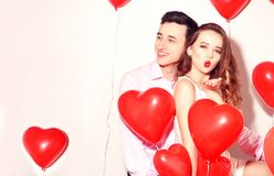 Man with his lovely sweetheart girl have fun at Lover`s valentine day. Valentine Couple. Couple happy. Girl send kiss. stock photography