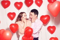 Man with his lovely sweetheart girl shocked . Lover`s valentine day. Valentine Couple. Couple surprised, very happy, discounts royalty free stock photography