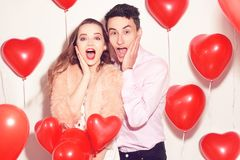 Man with his lovely sweetheart girl shocked . Lover`s valentine day. Valentine Couple. Couple surprised, very happy, discounts royalty free stock photos