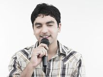 Man with his mike singing Royalty Free Stock Images