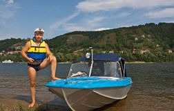 Man and his motor-boat royalty free stock photography