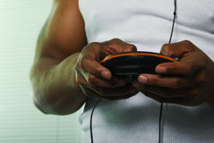 Man and his music. African american male holding a cd player in a white tee shirt Stock Photo