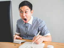 Man at his office desk. Stock Images