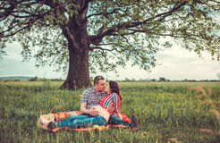 Man with his pregnant wife on open air Stock Photos