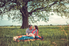 Man with his pregnant wife on open air Stock Photo