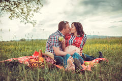 Man with his pregnant wife on open air Stock Photography
