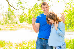 Man and his pregnant wife in a park Stock Photography
