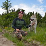 Man and his purebred Czechoslovakian wolf dog. Outdoor Stock Photos