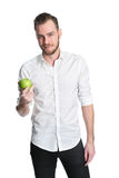 Man in his 20s holding an apple Royalty Free Stock Image
