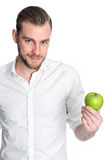Man in his 20s holding an apple Stock Photo