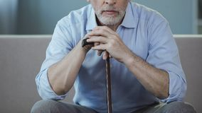 Man in his 50s sitting on sofa and thinking about his life, loneliness period Stock Images