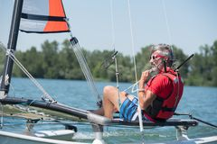 Man in his sailboat Royalty Free Stock Photo