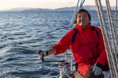 Man on his sailing yacht. Sport. Royalty Free Stock Images