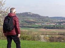 Older man enjoying beautiful landscape stock photography