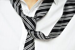 Loose tie. A man with his shirt and his tie loosened Stock Images