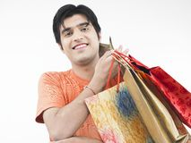 Man with his shopping bags. Asian male of indian origin with his shopping bags Stock Images