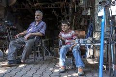 A man and his son in the Adiyaman bazaar in Adiyaman in eastern Turkey. Stock Photography