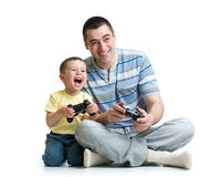 Man and his son child play with a playstation toge Stock Photos