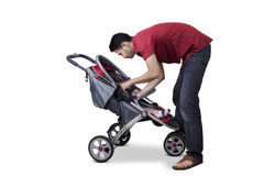 Man and his son inside a stroller Stock Images