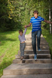 Father and son in a jump Royalty Free Stock Images