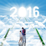 Man and his son on the stairs with numbers 2016 Royalty Free Stock Photo