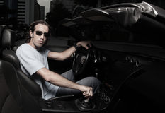 Man in his sports car Stock Photos