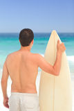 Man with his surfboard Stock Photos
