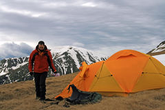 Man and his tent Stock Images
