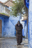 A man and his thoughts, Chefchaouen. A man and his thoughts through the streets of Chefchaouen, Morocco Royalty Free Stock Image