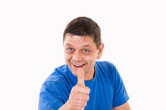 A man with his thumb pointing upwards Stock Photos