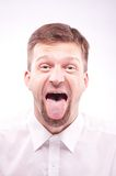 Man with his tongue out. Portrait of a man with his tongue out Stock Images