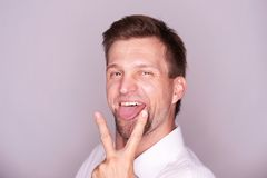 Man with his tongue out Royalty Free Stock Images