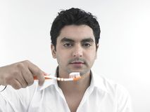 Man and his toothbrush Stock Photo