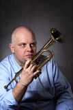Man and his trumpet portrait Stock Photos