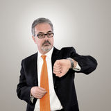 Man and his watch Stock Photography